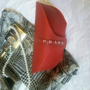 Prada sun glasses case red white name